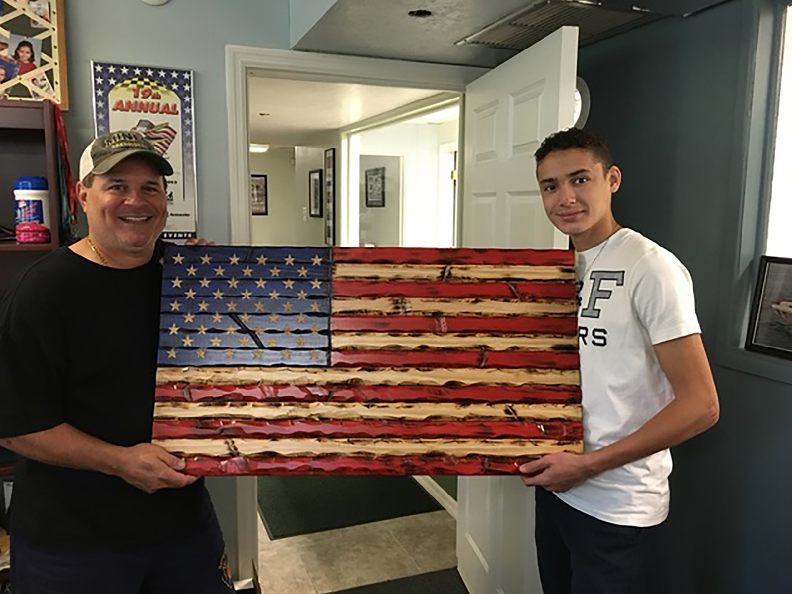 15-year-old boy is carving wooden flags to support 'forgotten heroes,' like veterans and first responders, during the pandemic
