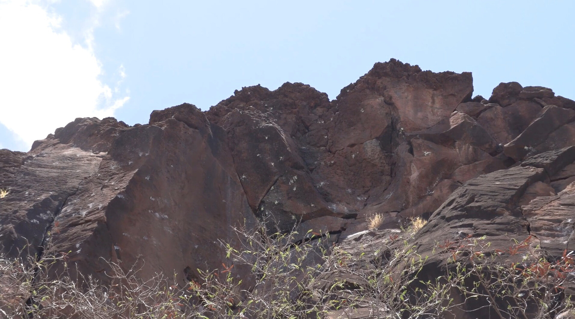 Hawaiian authorities ask for help after historic cliff carvings were vandalized with paintballs