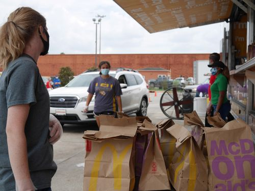 Image for Two days after Hurricane Laura, a McDonald's business owner gave away 10,000 free meals from a portable restaurant