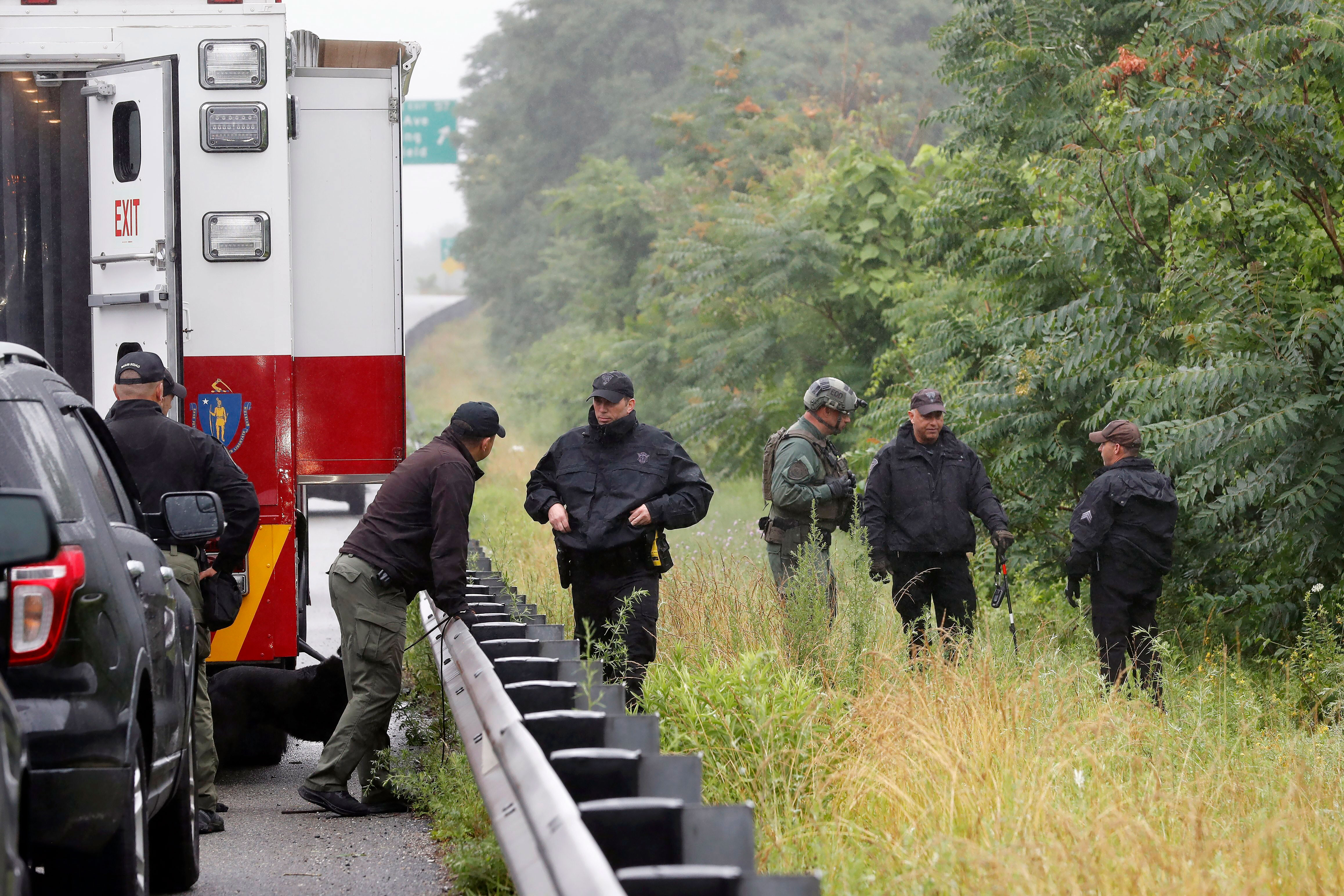 Authorities charge 11 people involved in a standoff with Massachusetts police