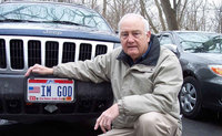 A man was awarded over $150K after he was denied a license plate that read 'IM GOD'
