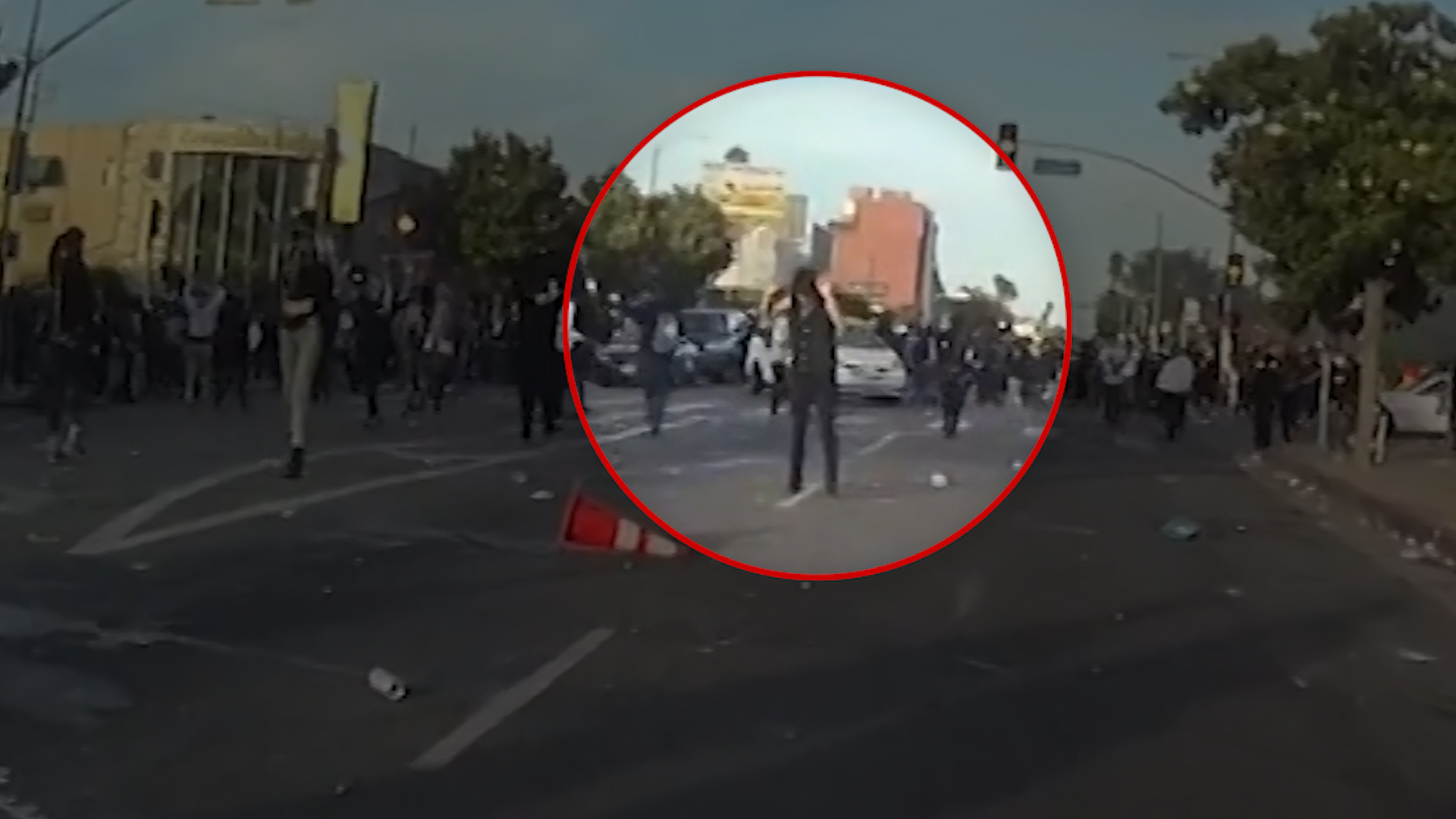 LAPD releases video showing protester shot in head with 'less-lethal' round