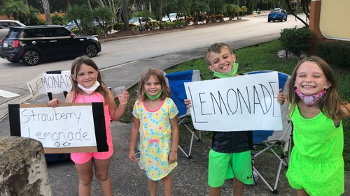 Image for She lost her business due to coronavirus. Now she's supporting her four children by running their lemonade stand