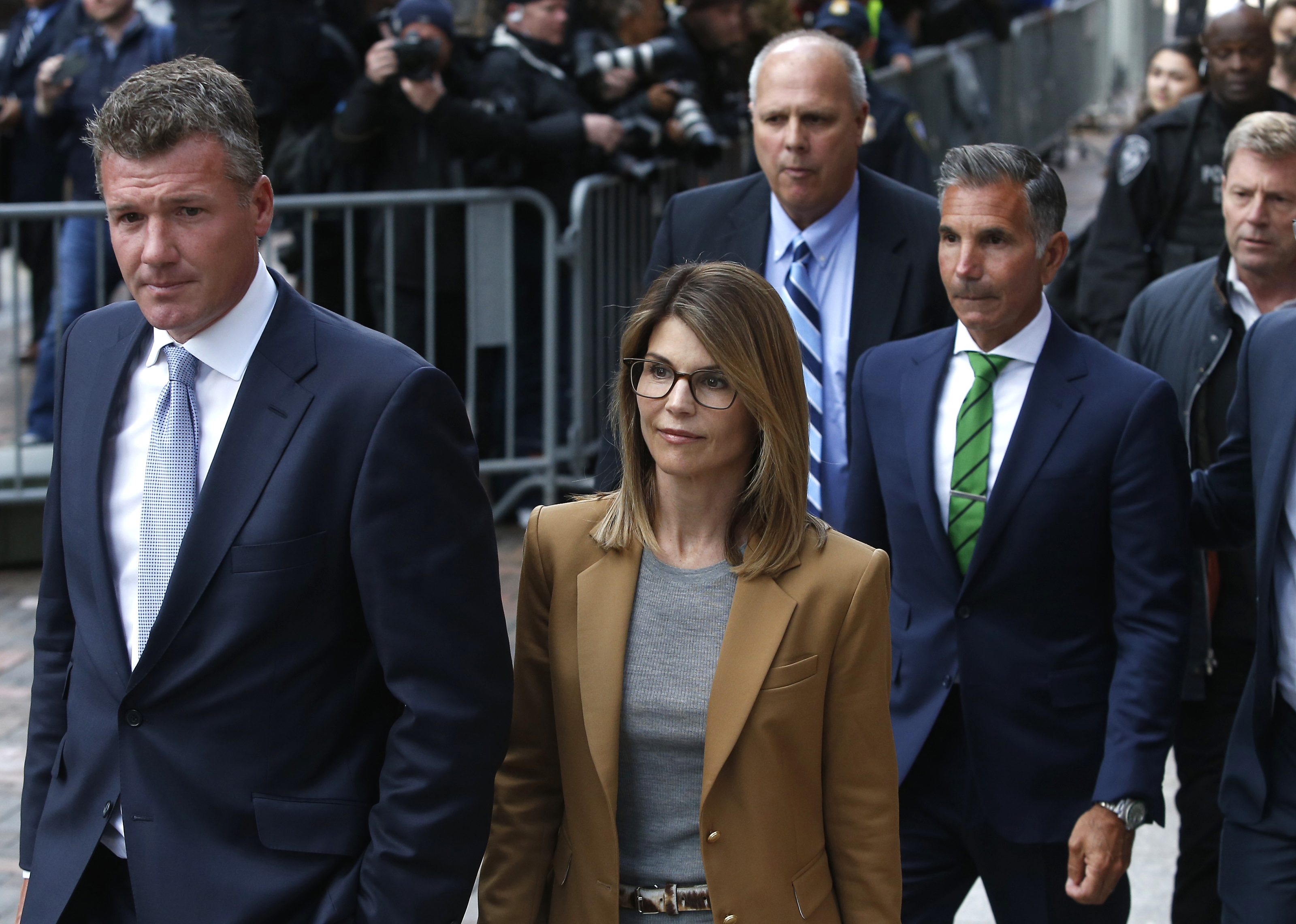 Attorneys for Lori Loughlin and husband say government 'appears to be concealing' evidence beneficial to the defense