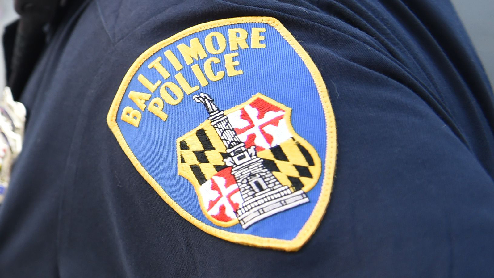A Baltimore police sergeant was spat on and kicked during a check, authorities say