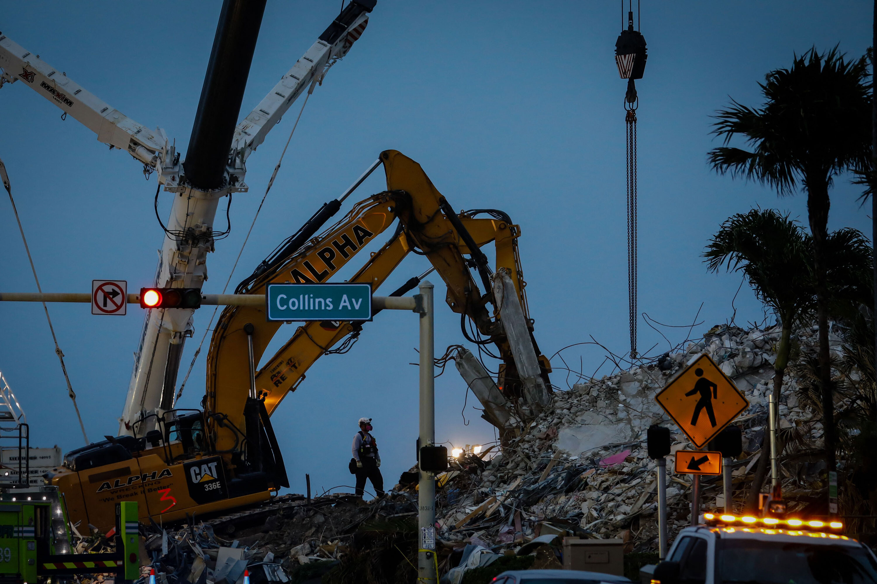 Death toll rises to 86 as recovery teams battle inclement weather at Surfside collapse site