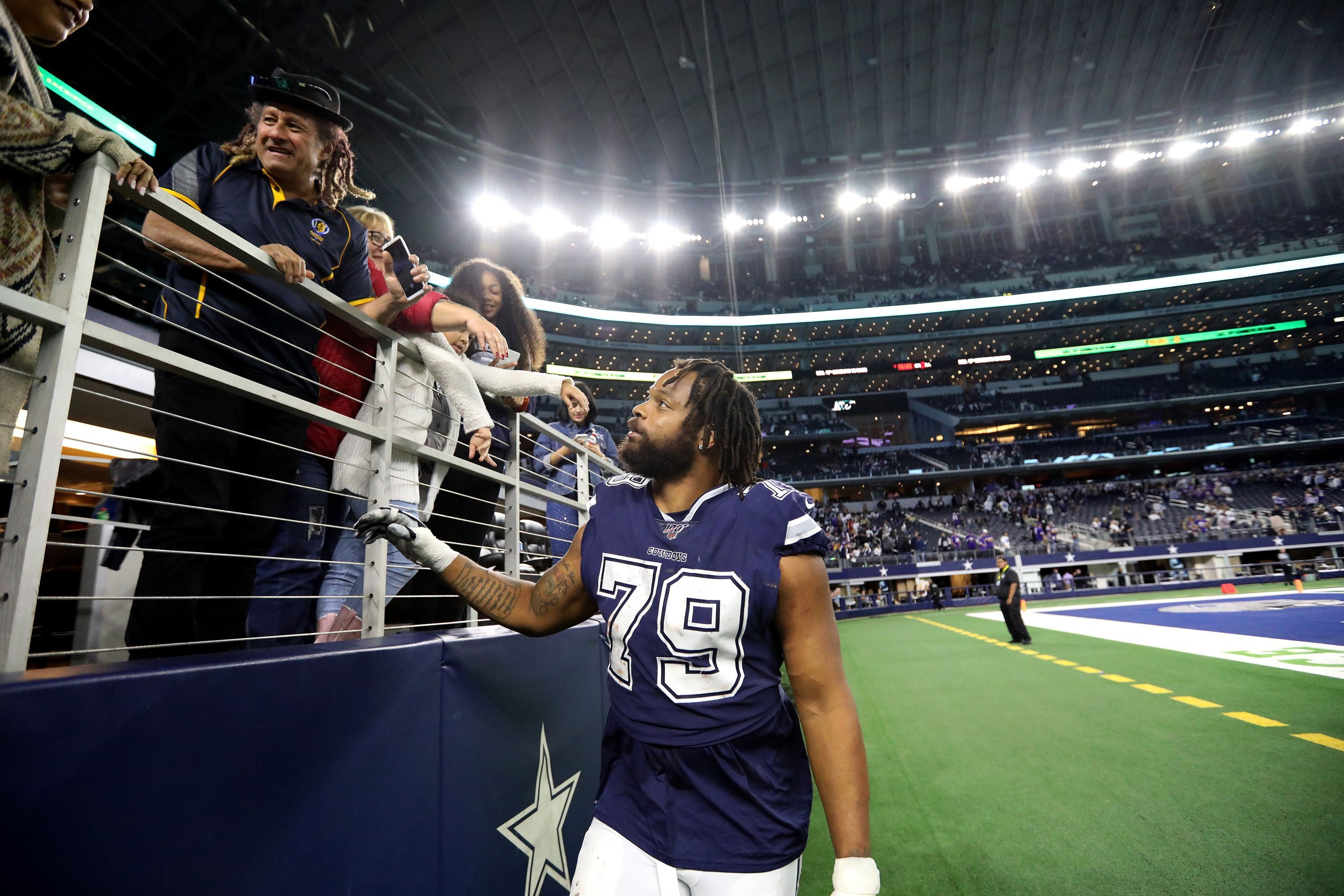 Michael Bennett says he's standing for the National Anthem because his Cowboys teammates asked him to
