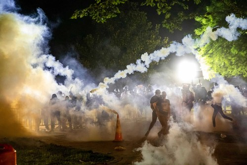 Image for The military is banned from using tear gas on the battlefield, but police can use it on crowds at home. Here's why