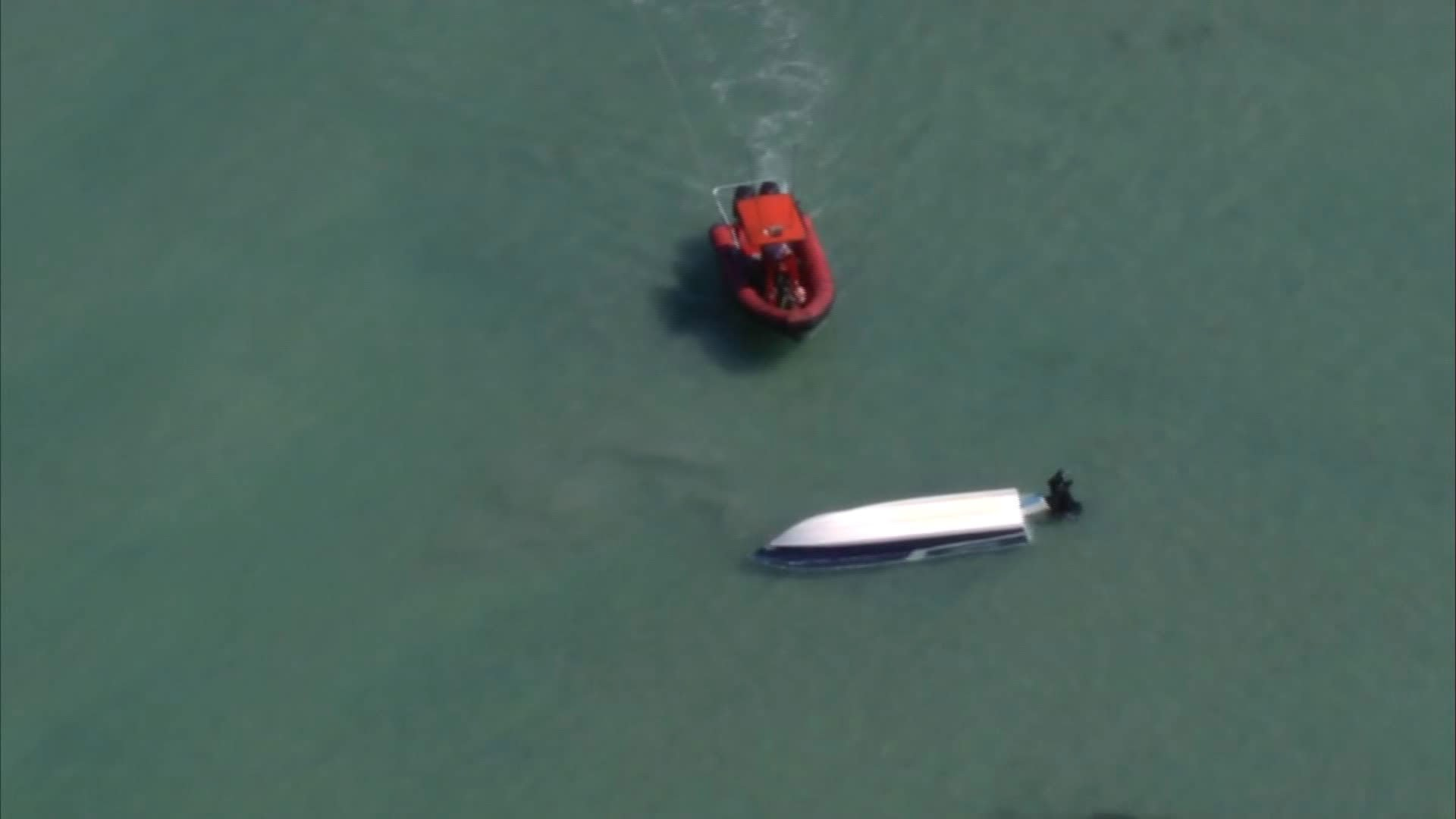 The US Coast Guard is searching for two missing boaters after a storm capsized their vessel