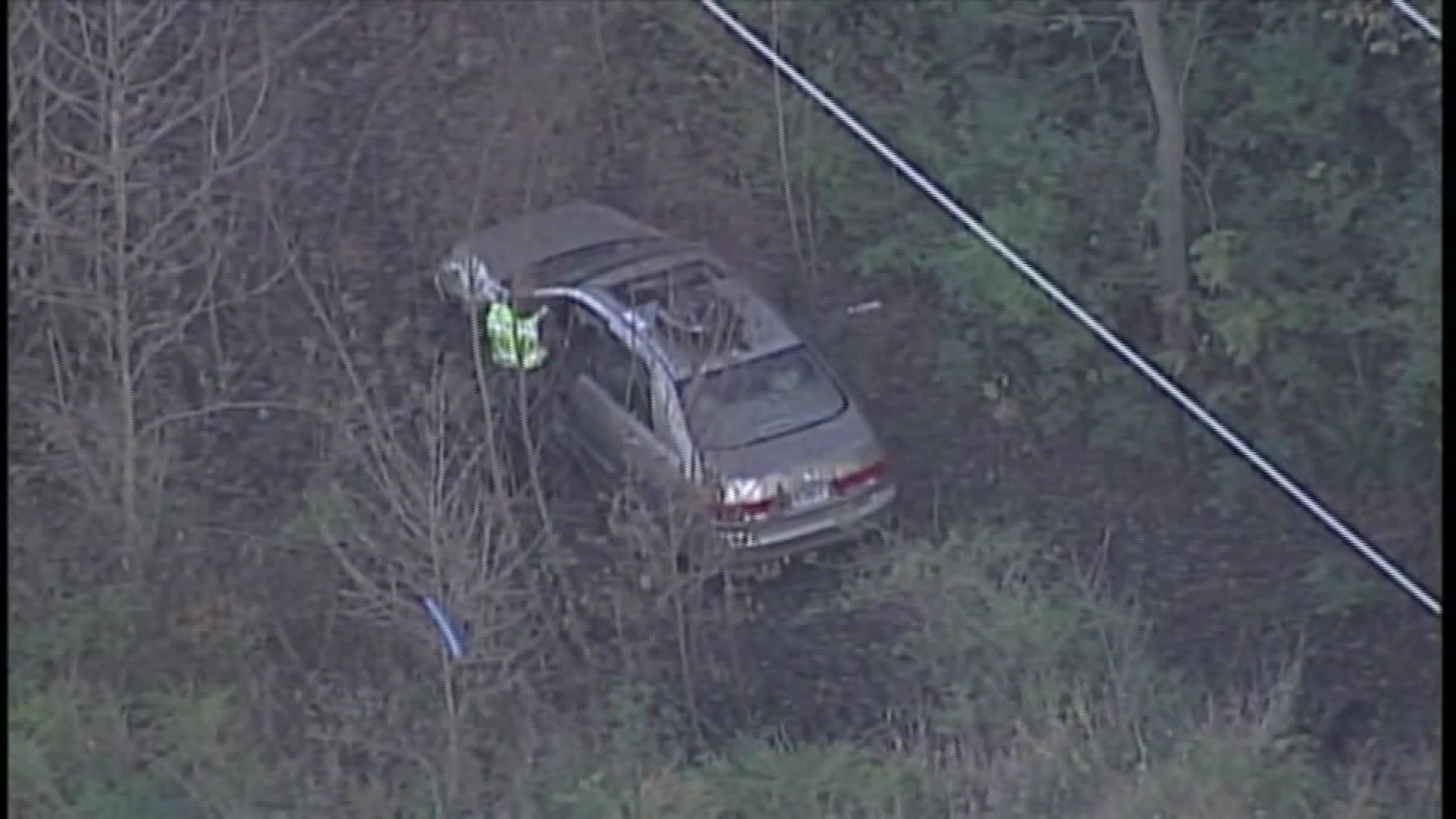 A man who survived a week in his car at the bottom of a ravine has died, police say