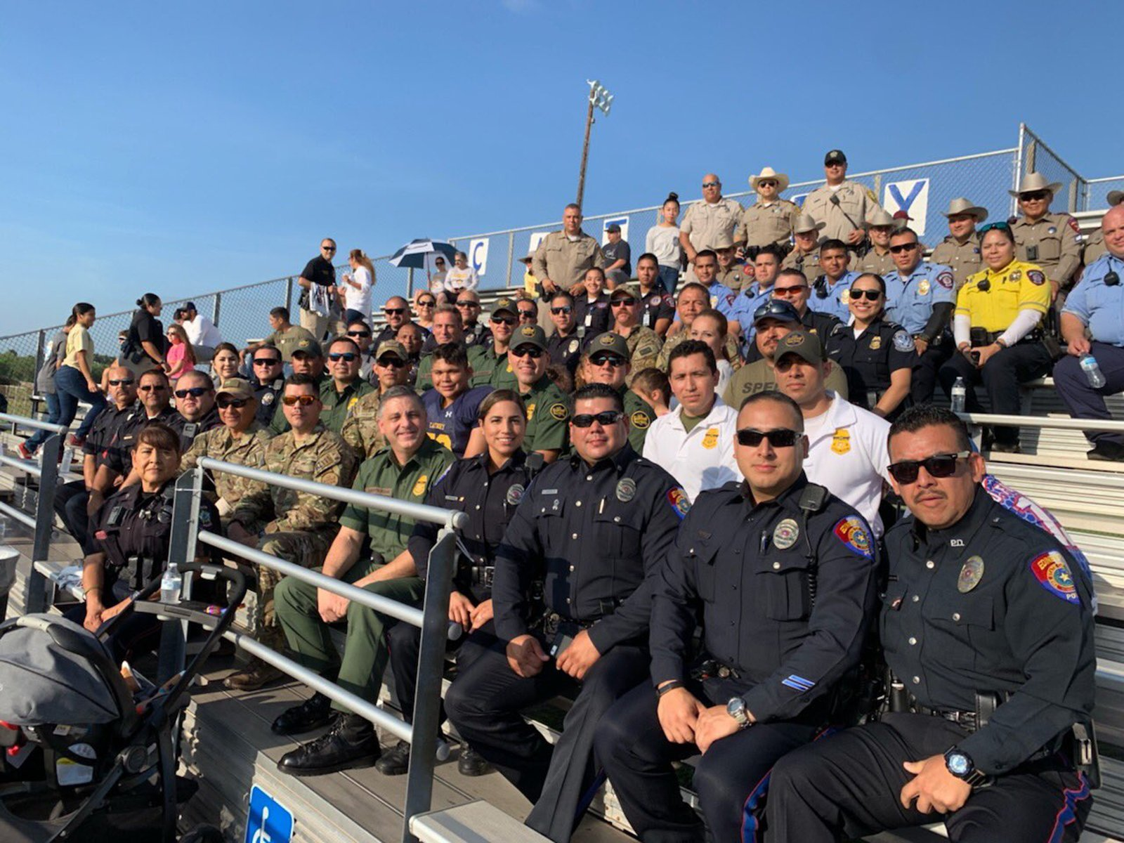 Joaquin's dad died in the line of duty, so dozens of police came to watch his first football game