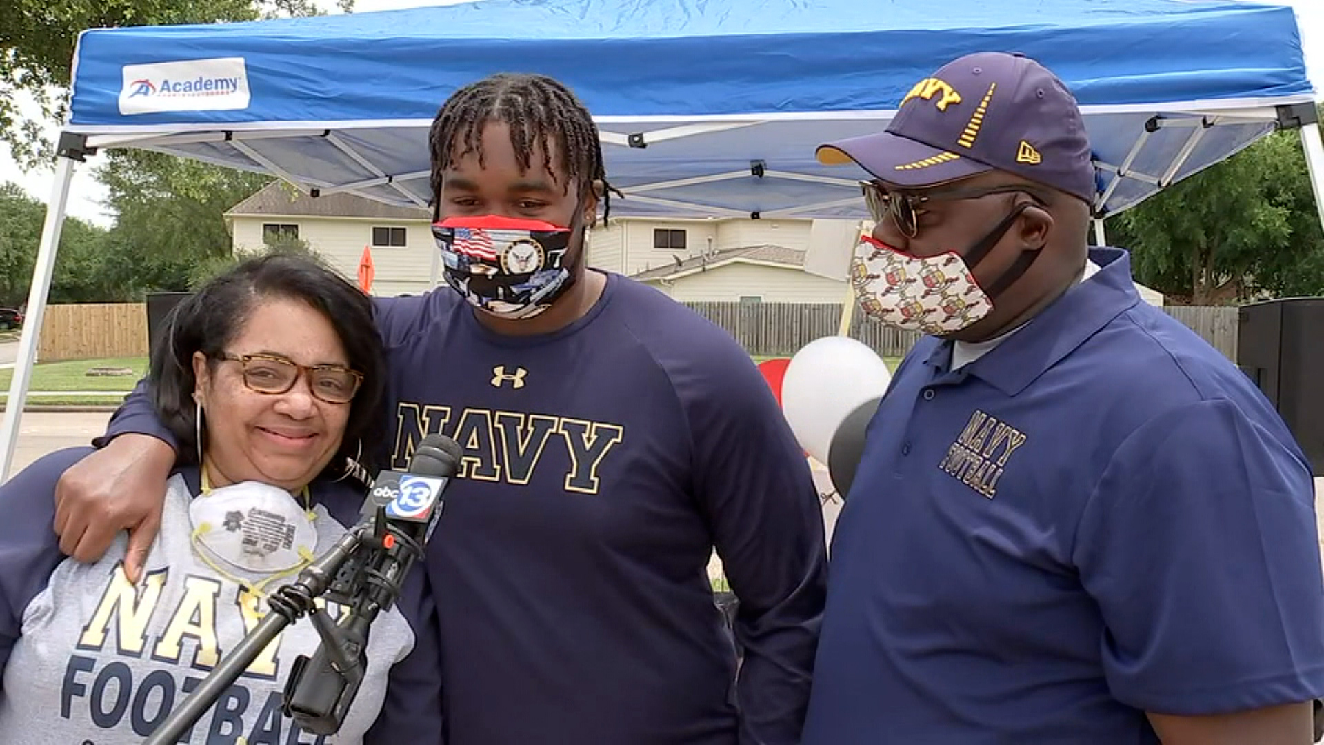 The mother of a Naval Academy football prospect is killed by random gunfire after dropping off her son at school