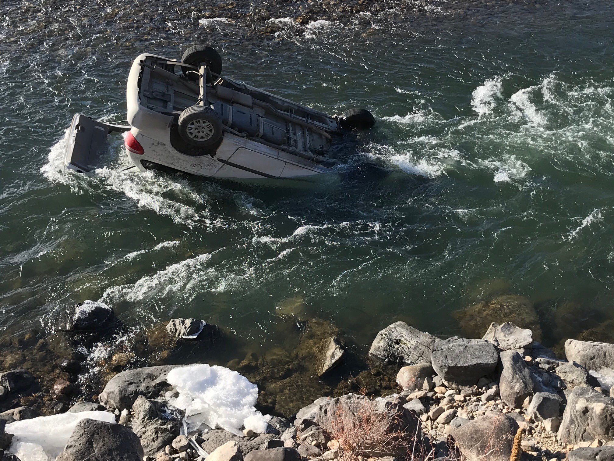 Montana trooper rescues driver from car submerged in icy river