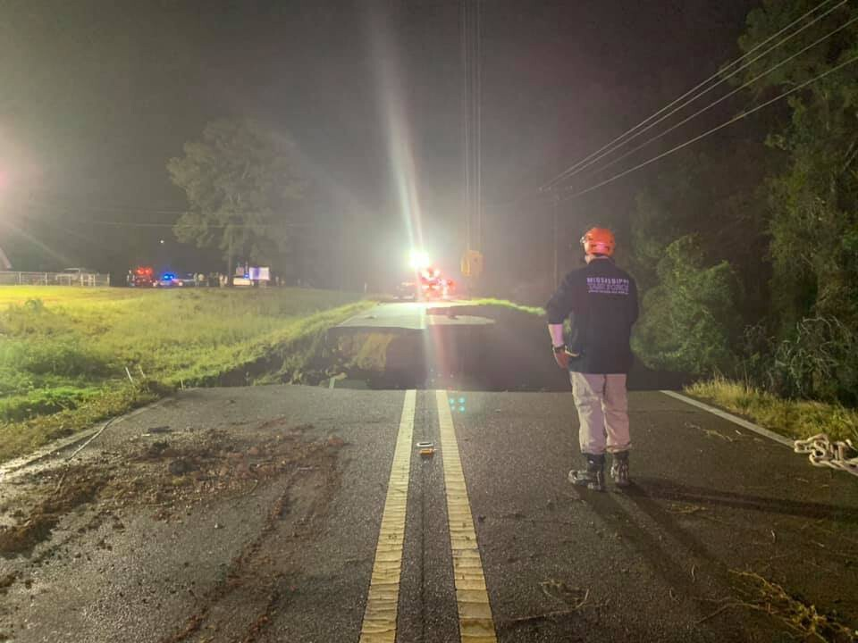 Two dead and 10 injured after Mississippi highway washed away by heavy rain
