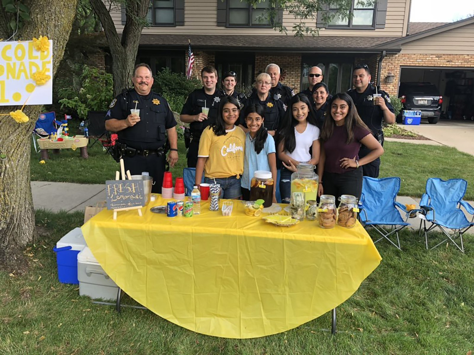 Thieves stole $9 from a girl's lemonade stand for charity. Police and neighbors rallied to give her more than $300