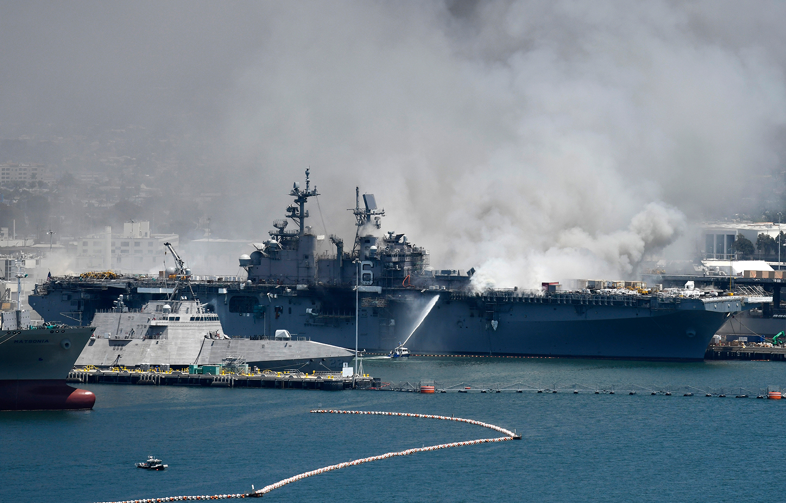 Federal firefighters battling blaze on US Navy ship that could last for days