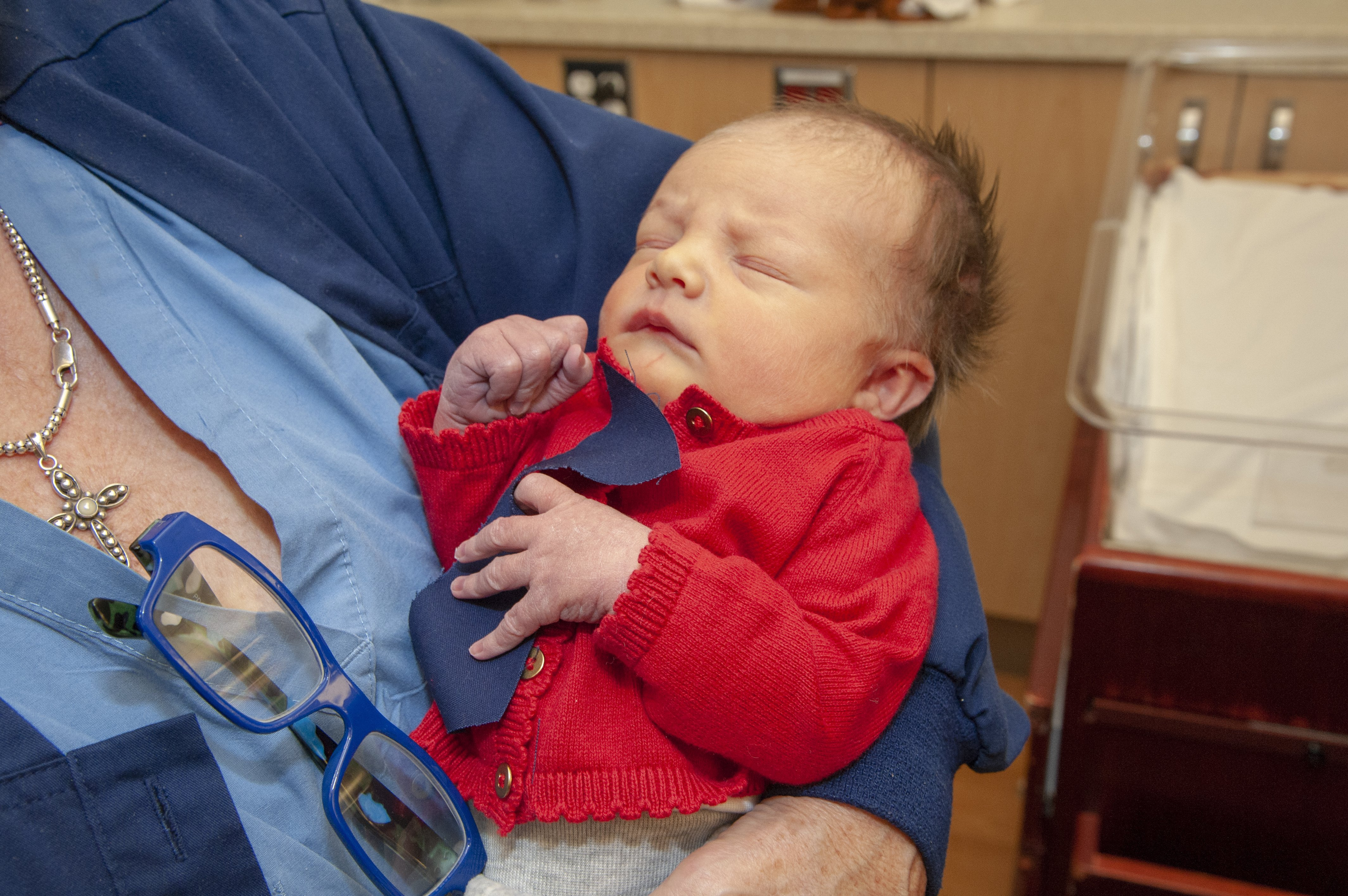 Newborn babies at a Pittsburgh hospital dressed up as Mister Rogers for Cardigan Day