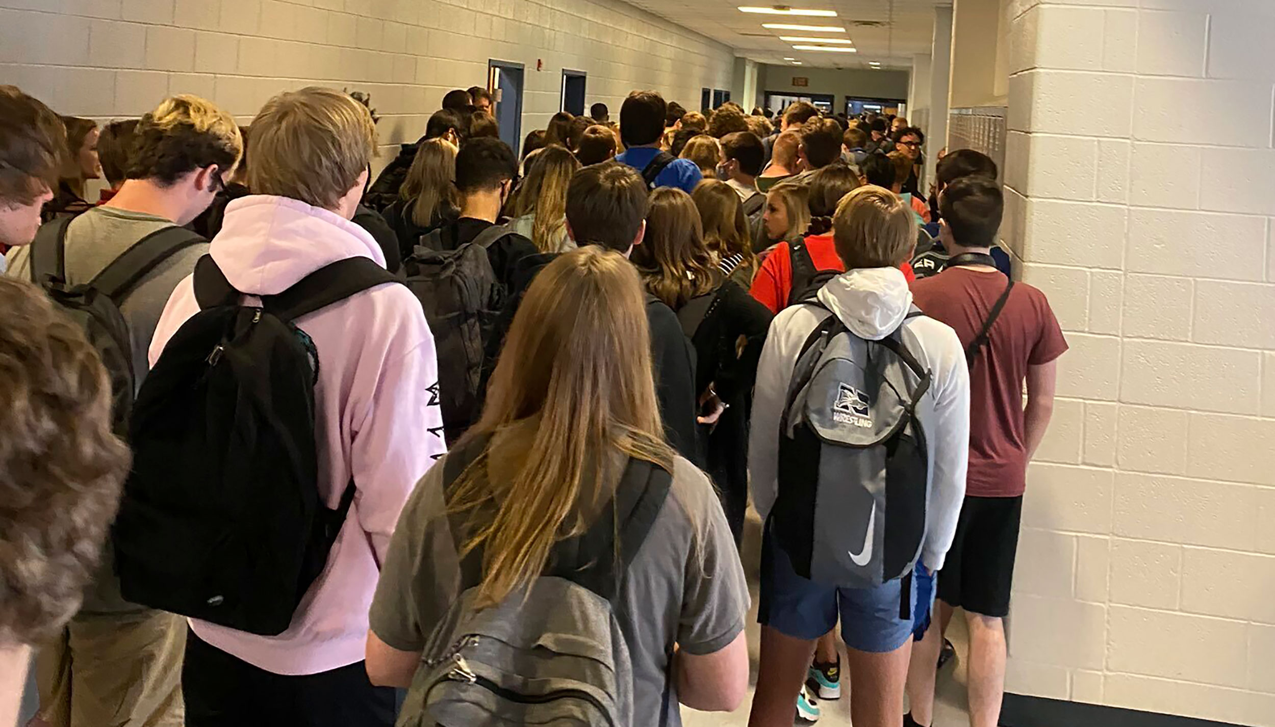 A school nurse in the district with the crowded hallway photo quit over a scarcity of Covid-19 precautions. Rising cases are 'not the validation' she wanted