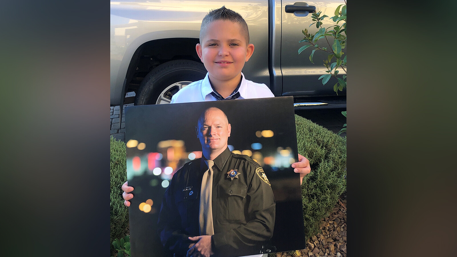 His dad, a police officer, died from Covid-19. Fellow officers escorted him to his first day of school