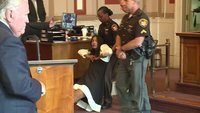 A former Ohio judge was dragged from court after her sentencing