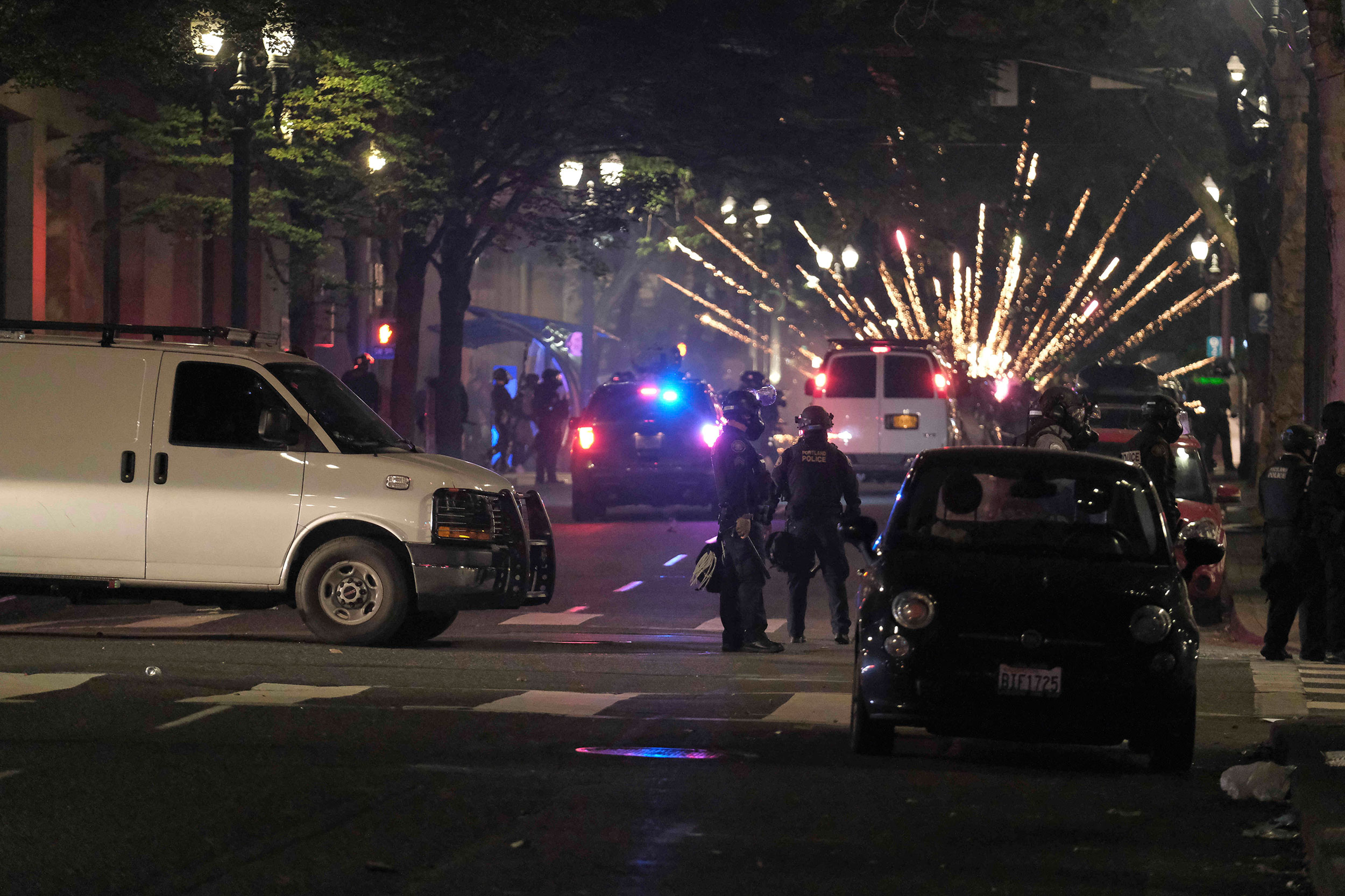 Portland demonstration declared a riot after protesters launch fireworks at federal courthouse