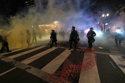Image for Portland demonstration declared a riot after protesters launch fireworks at federal courthouse