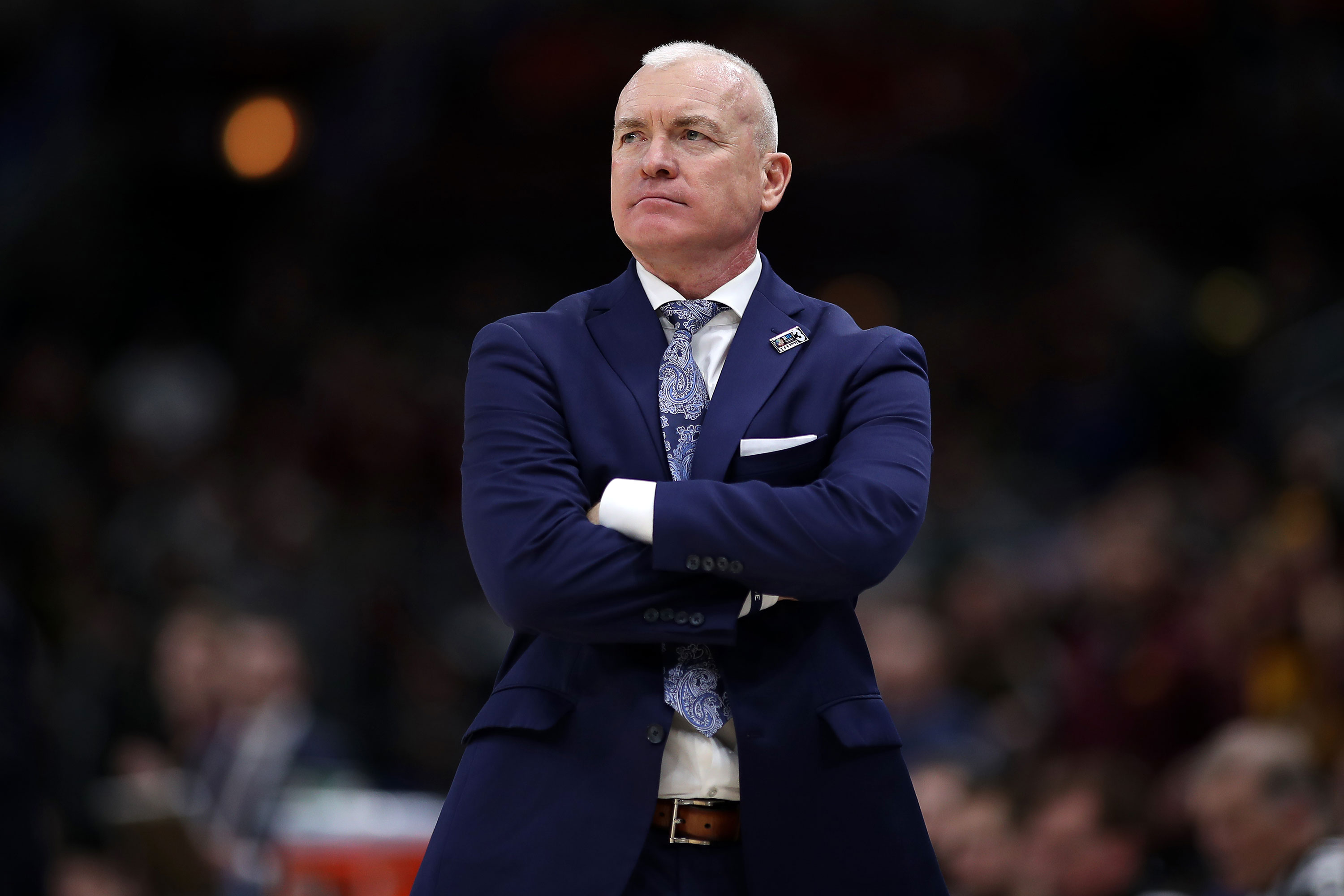 A remark about a noose around a player's neck led to Penn State basketball coach's resignation