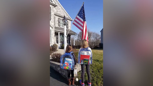 Image for These girls aren't in school but they're still saying the Pledge of Allegiance
