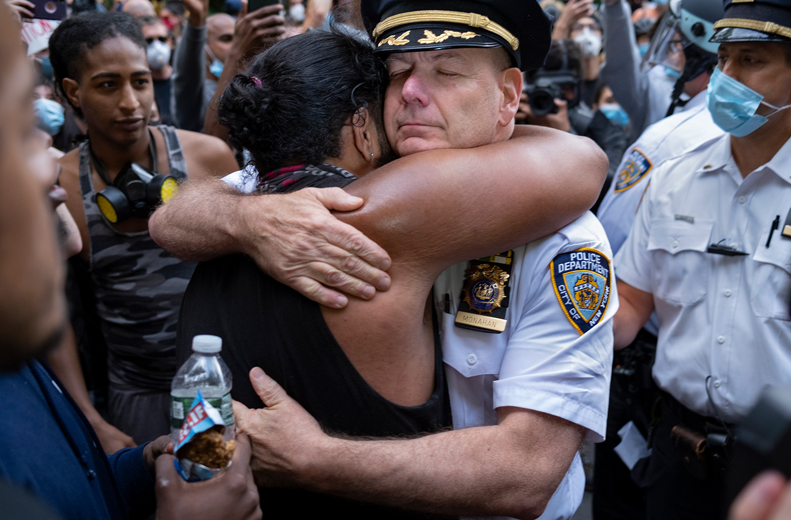 Police officers are joining protesters for prayers and hugs in several US cities