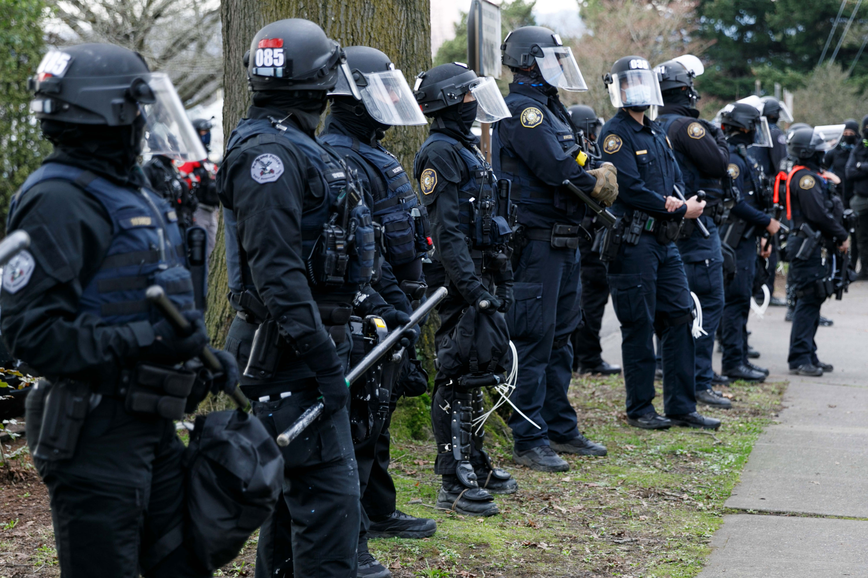 Four people charged in Portland after demonstrators vandalized federal ICE building, Democratic Party state headquarters
