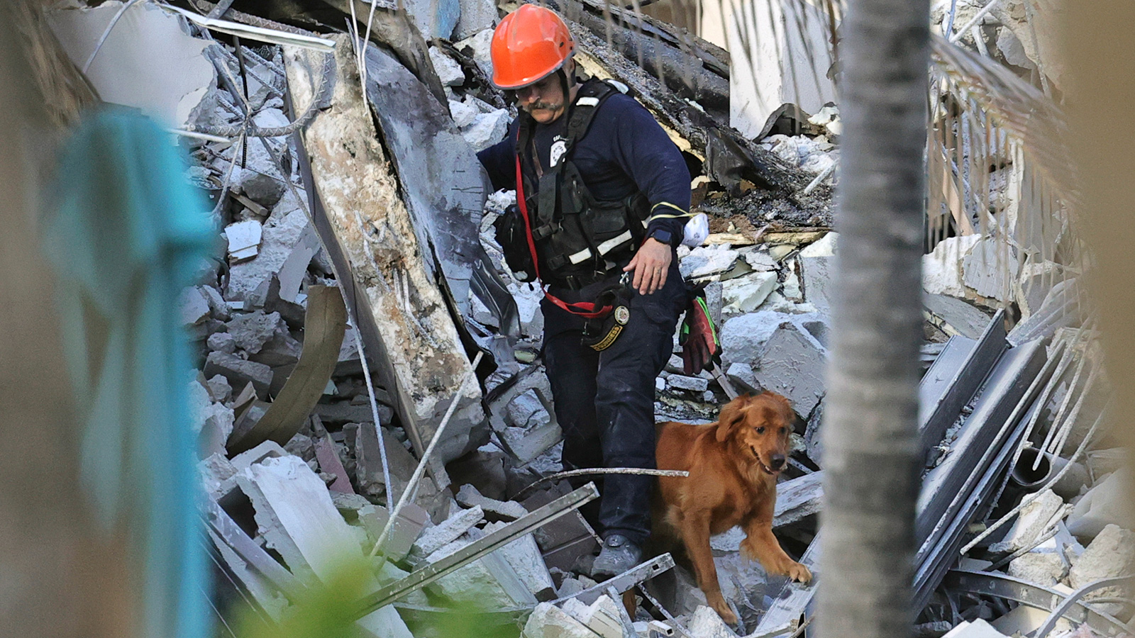 Rescuers battle fire, noise and shifting steel and concrete as they scramble to save lives