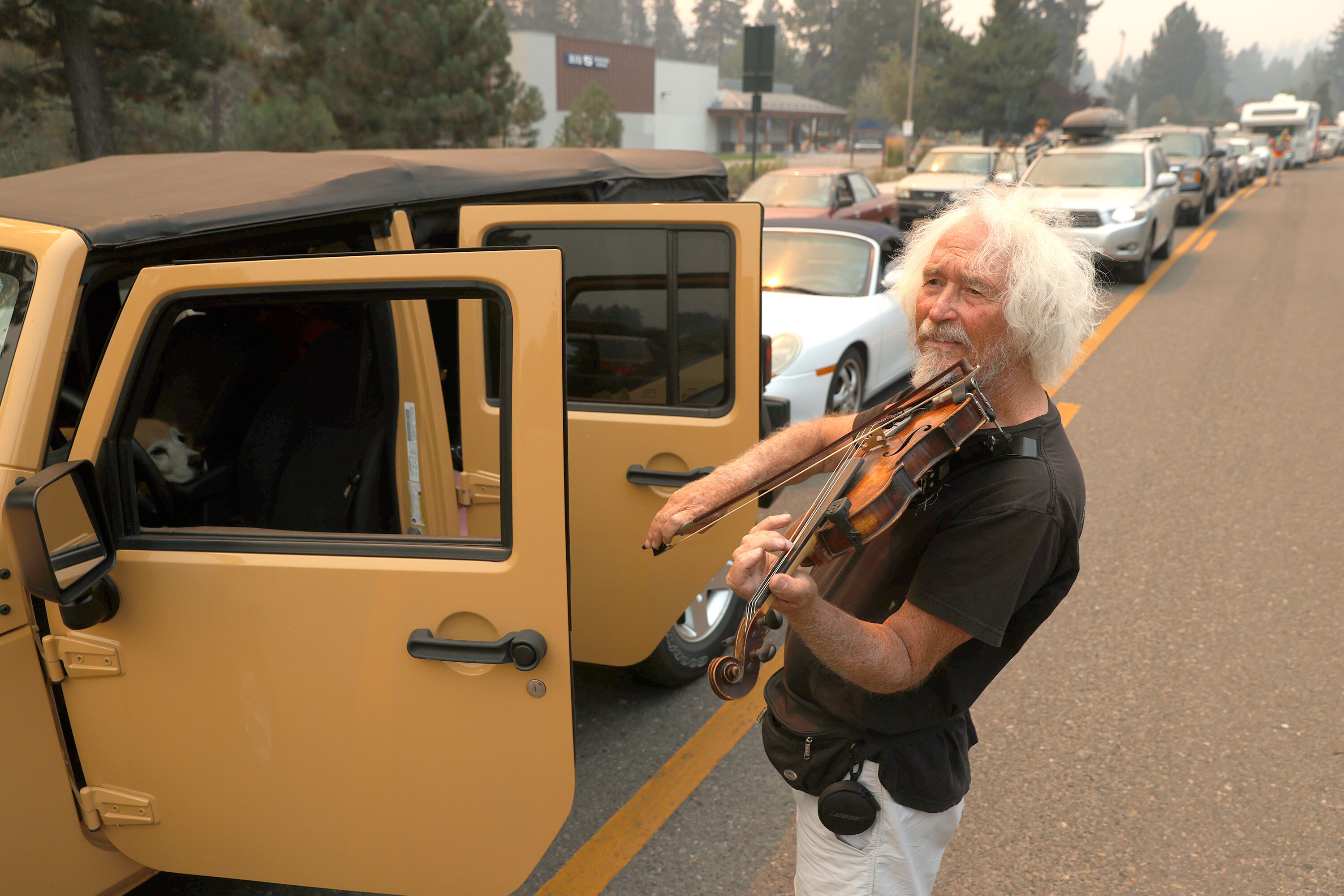 A Lake Tahoe resident played the violin as his family sat at standstill in Caldor Fire evacuation traffic