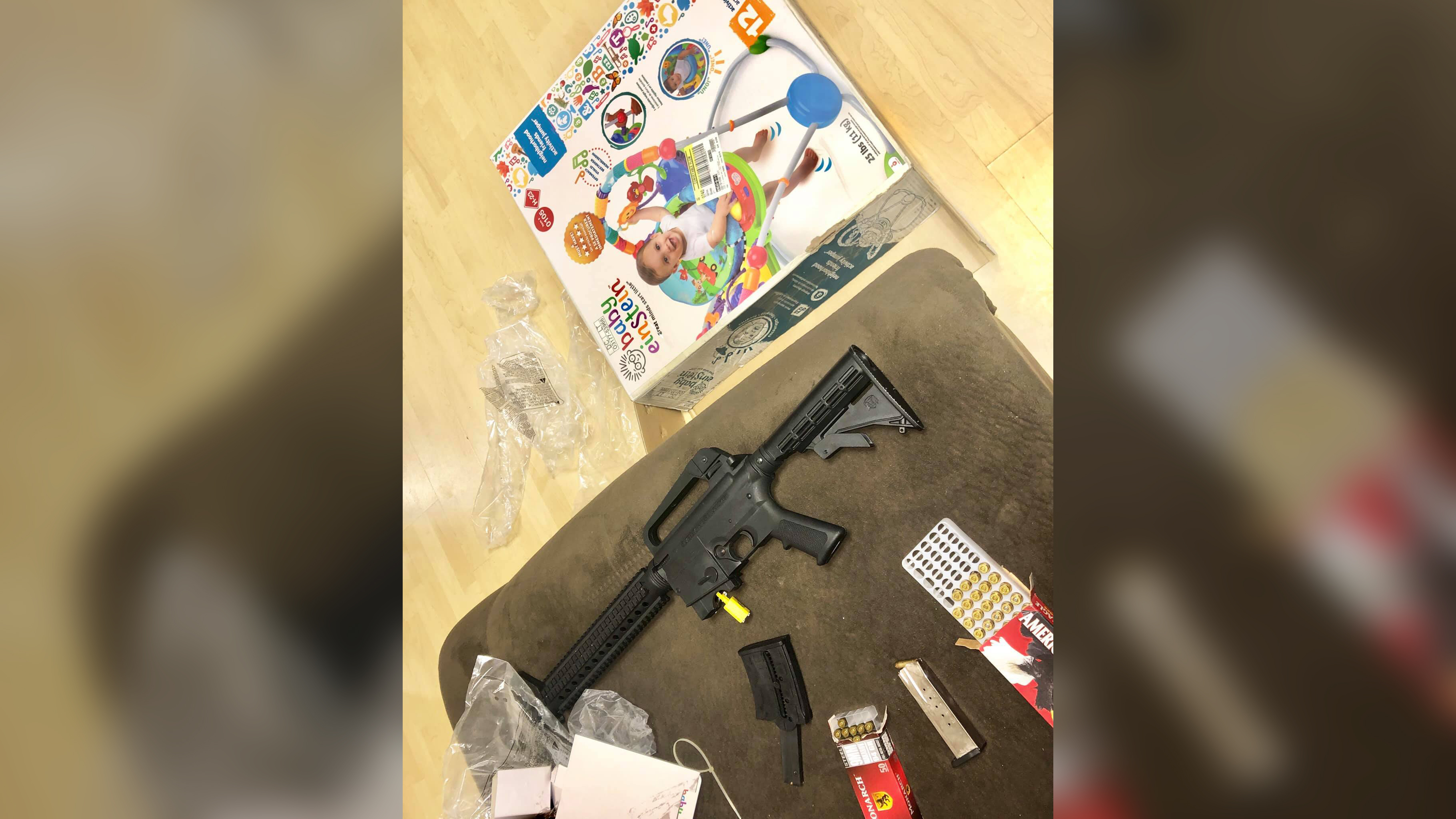 A woman bought a gift at Goodwill. Instead of a baby bouncer, she says she found a loaded semi-automatic rifle inside