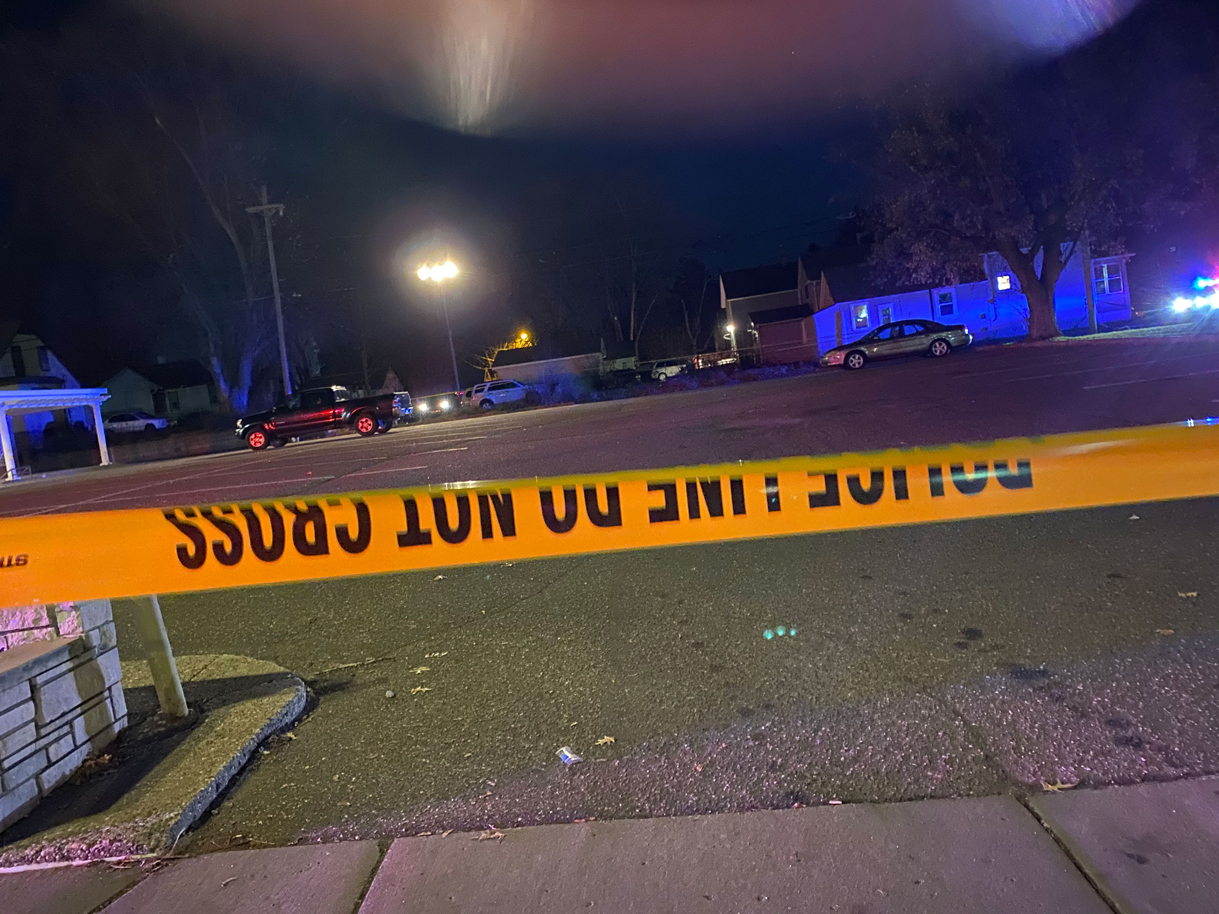 Man shot and hospitalized when, police say, he ran toward them after hiding in a dumpster