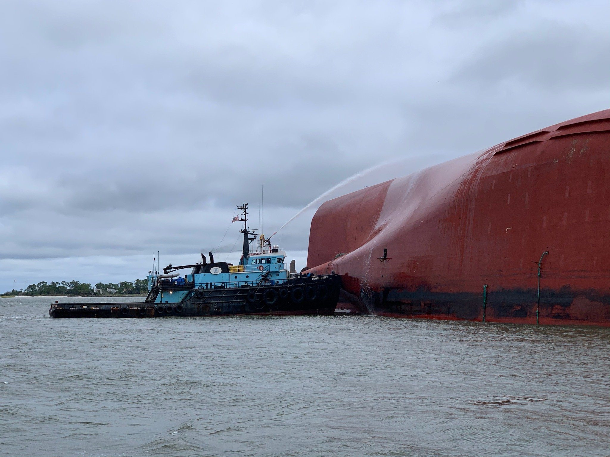 Crews have finished removing 320,000 gallons of oil and water from overturned cargo ship