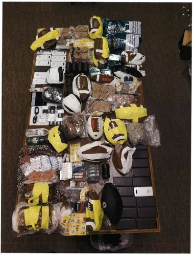 Image for Smugglers threw seven pounds of chicken wings and 40 pounds of tobacco over a prison wall