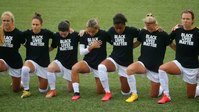 Women's soccer league players and officials kneel during National Anthem
