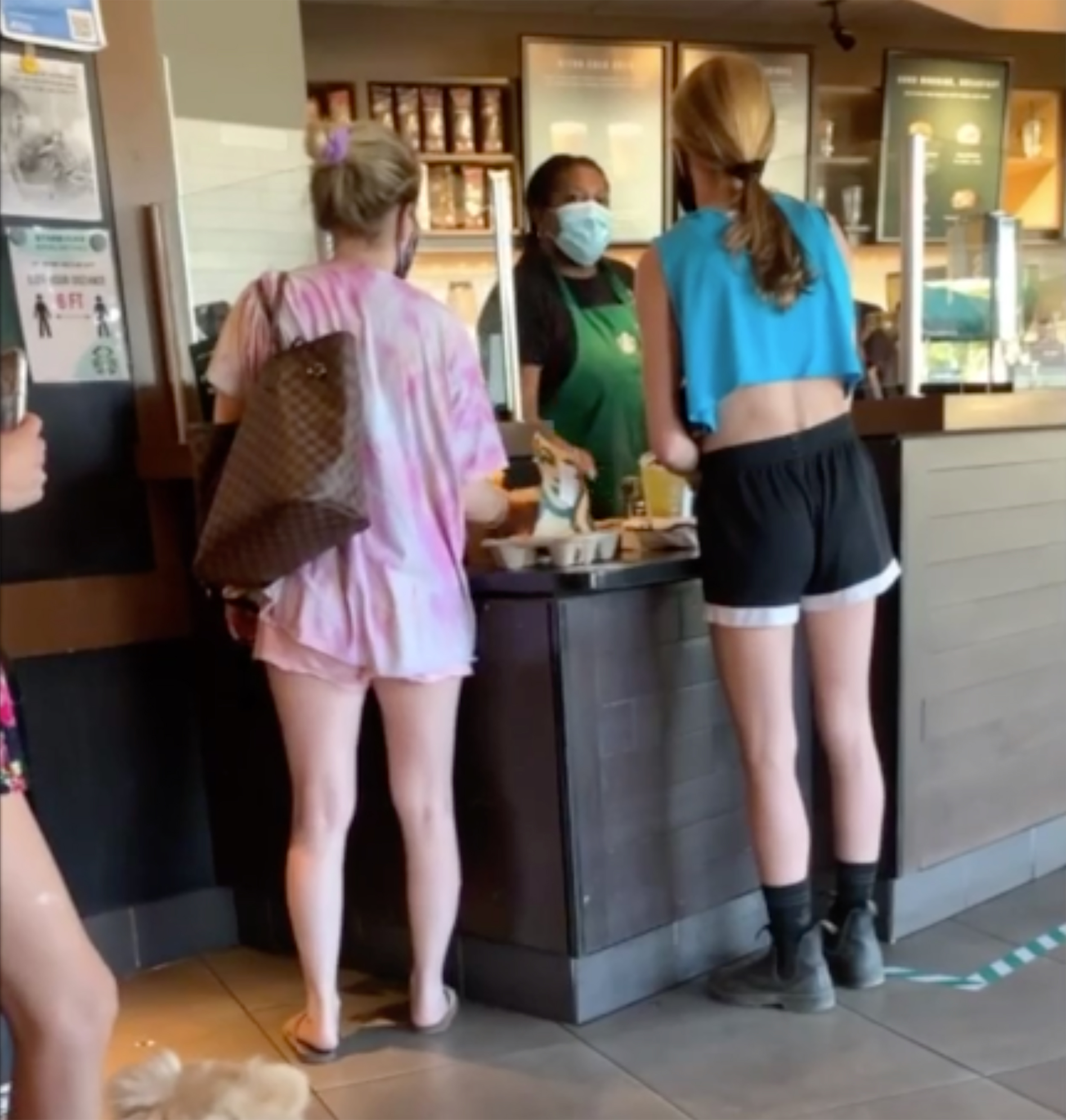White woman caught on video yelling obscenities at a Black Starbucks barista over face mask