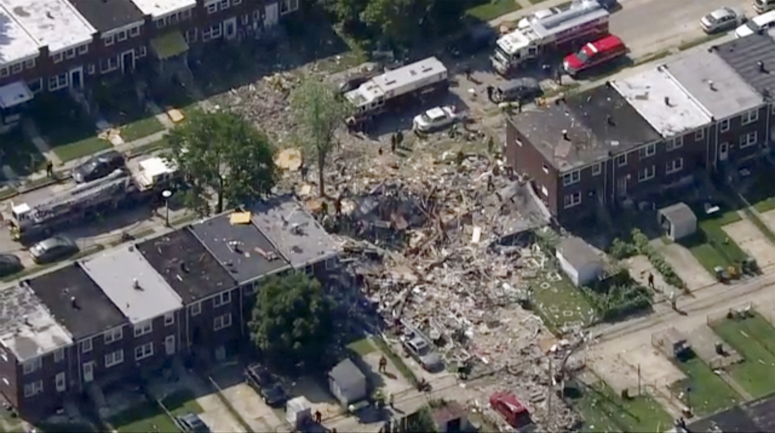 Explosion at homes in Baltimore kills 1 person and injures 7 others