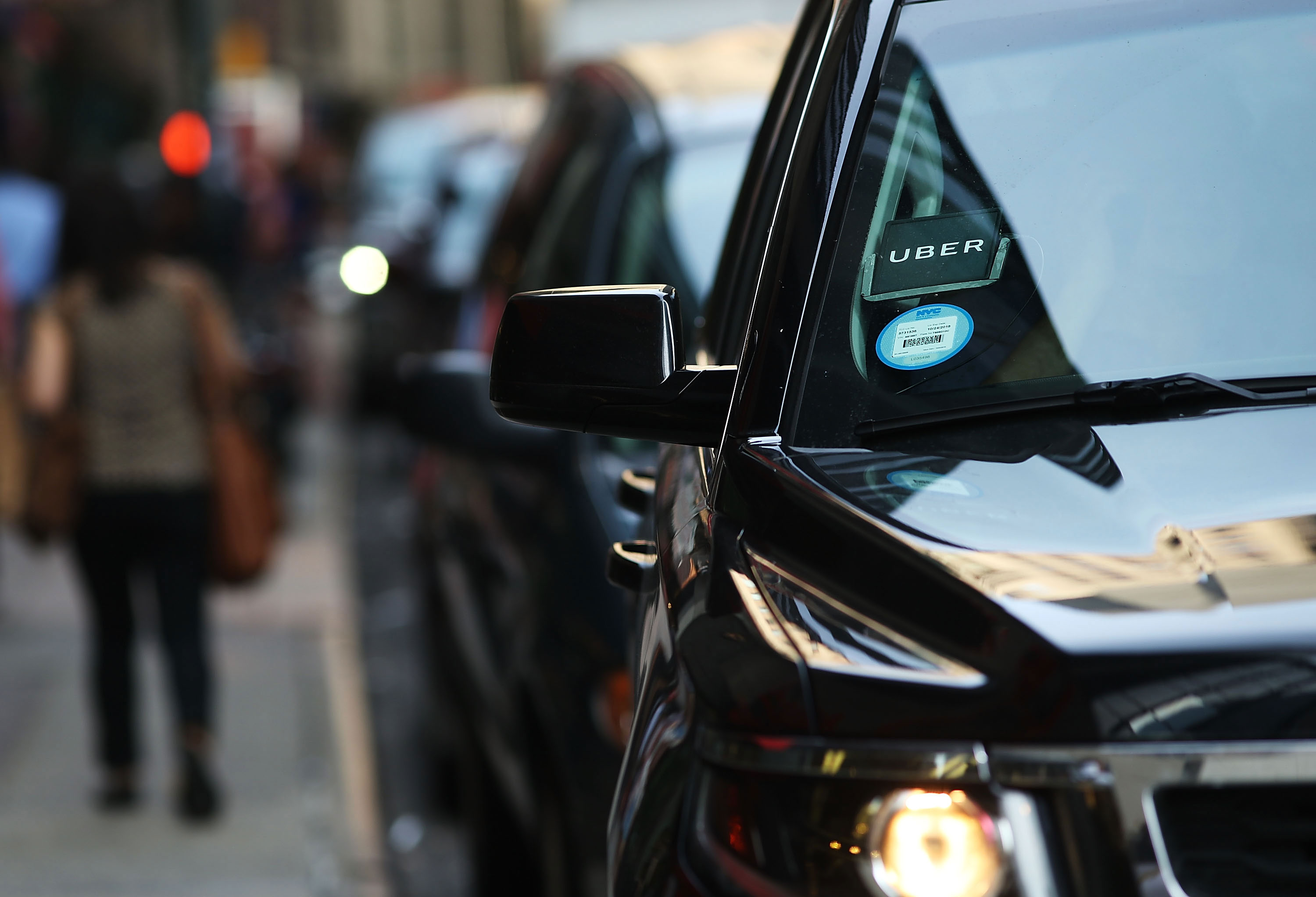 Uber and Lyft ride services paused for Tuesday night's curfew in New York City
