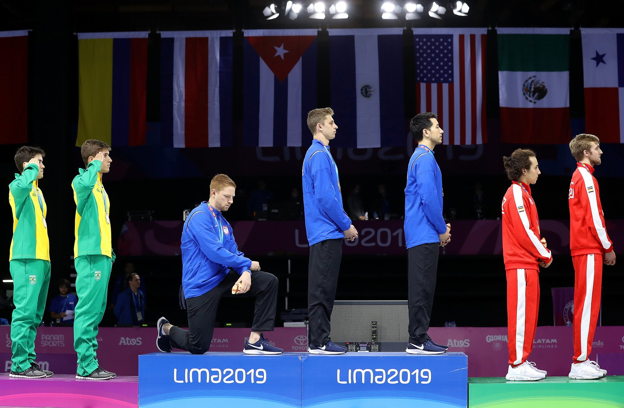 American gold medalist kneels during national anthem at the Pan Am