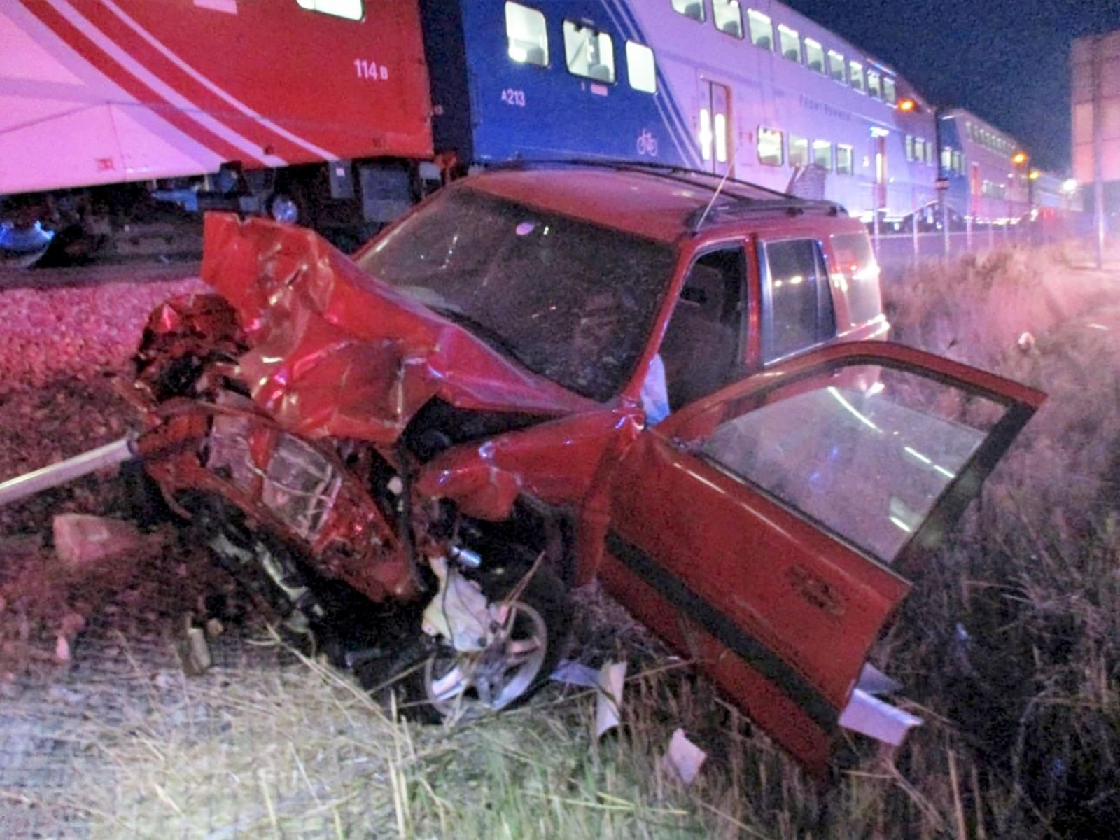 A state trooper pulled a man from his car seconds before it was hit by a train