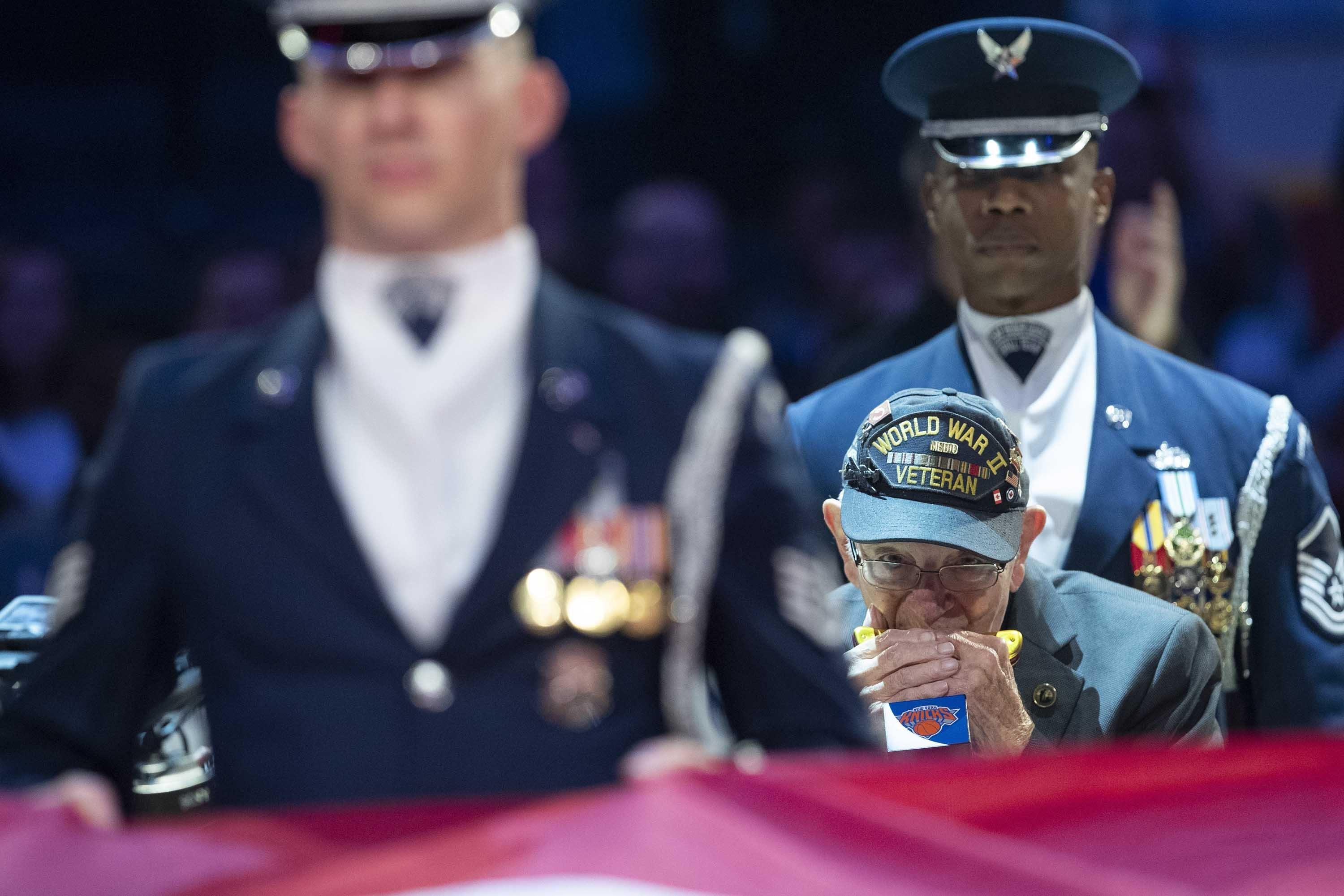 A WWII veteran wows the audience at an NBA game with his harmonica rendition of the National Anthem