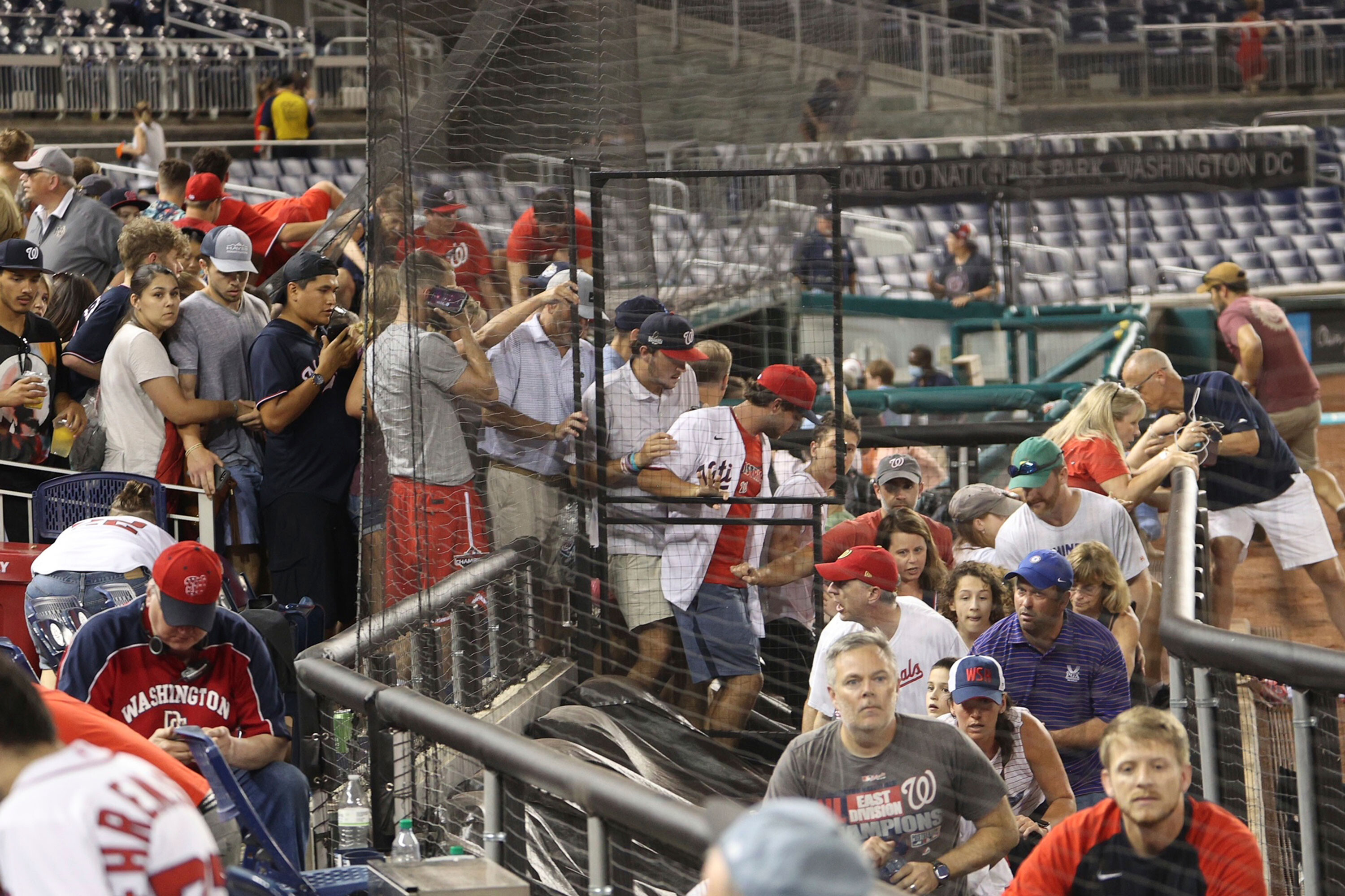 Police say 3 people were wounded in a shooting outside Nationals Park that sent players and fans scrambling during a game