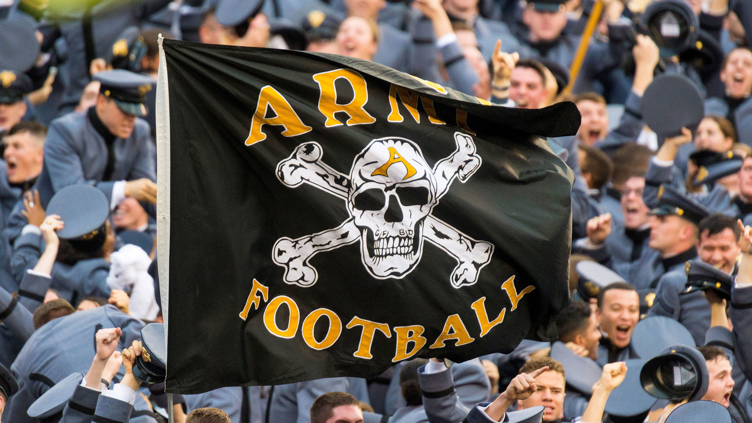 Motto linked to hate group removed from West Point football flag