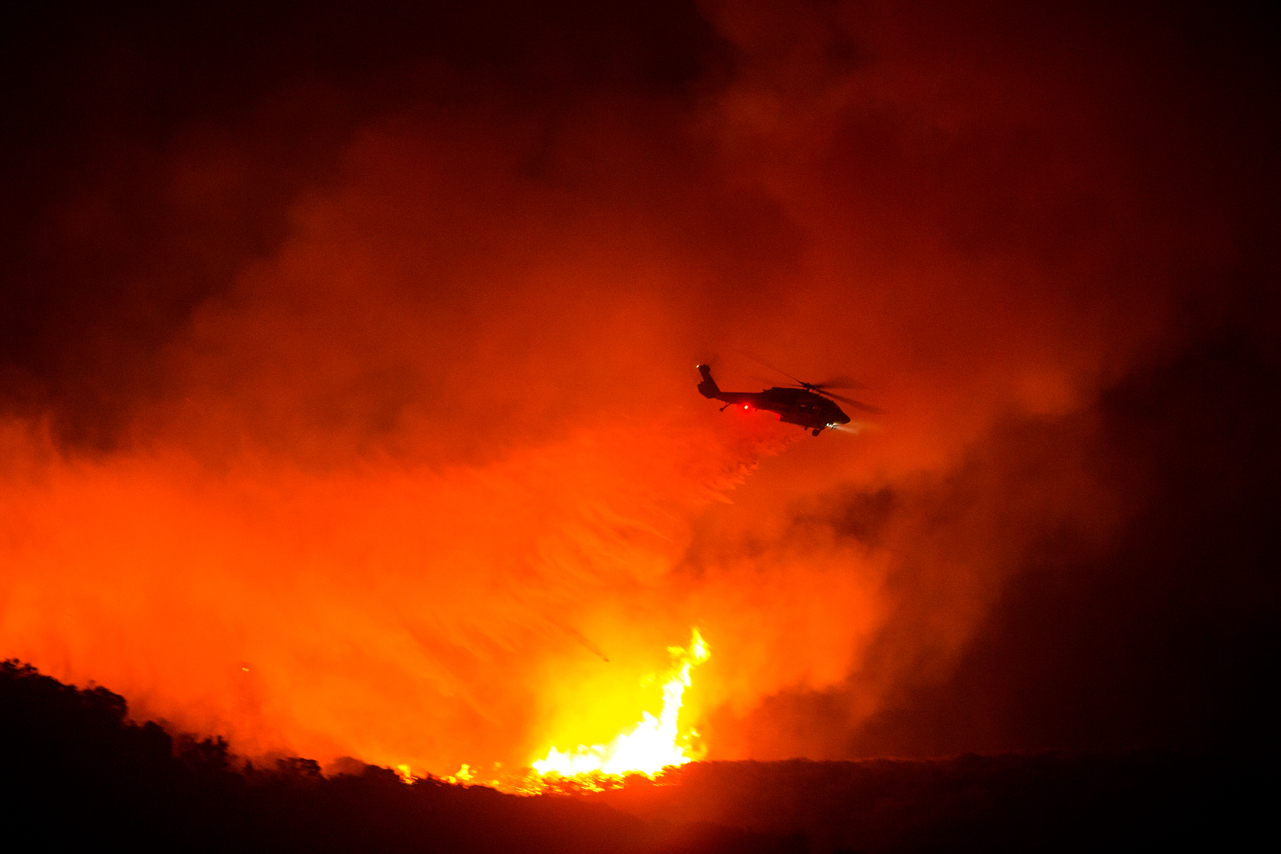 Wildfires have scorched about 100,000 acres in 3 states. The weather could make things worse