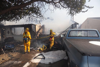 Wildfire destroys homes and forces evacuations in northern California