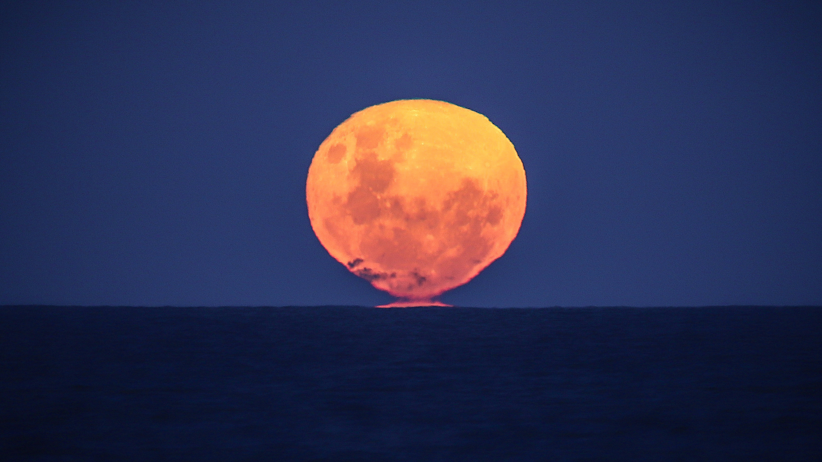 It's your last chance to see a supermoon this year with the 'strawberry' moon