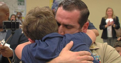 Image for Navy dad home from Iraq surprises son at school