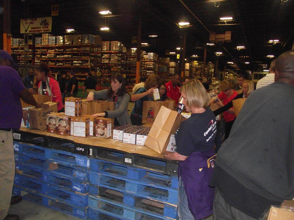 Bagging the Joy for the Greater Baton Rouge Food Bank - Coca-Cola UNITED